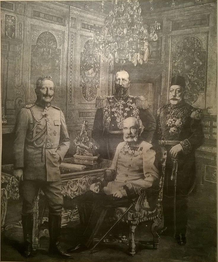 Karosszékében ül Ferenc József császár, előtte áll Vilmos császár és karszéke mögött két oldalt Ferdinánd bolgár cár meg a török szultán állnak.