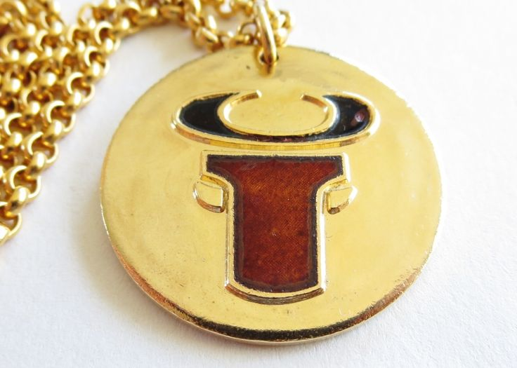 De Passillé-Sylvestre bull pendant. Enamel on gold tone metal.
