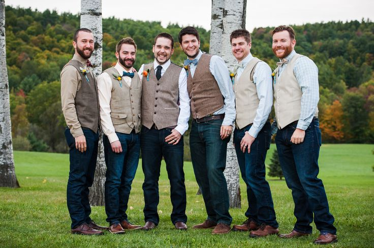 The groom and groomsmen fashion denim pants, neutral tone vests and bow ties for a quintessential look at a rustic chic wedding at the Historic Barns of Nipmoose. Hannah Photography