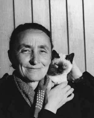 Georgia O'Keeffe with Siamese cat, New Mexico, by John Candelario, 1939. Palace of the Governors Photo Archives 165660.
