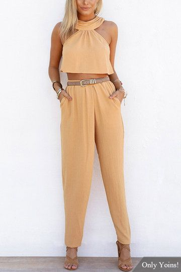 Don't strip down just yet. With this sexy long trousers co-ord set without belt, you'll want to wear it all day long. It is adorned with halter neck, sleeveless top and two pockets trousers. We love pair it with high heels.