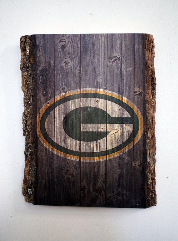 Green Bay Packers Design Transferred on Bass Wood  All NFL teams available on request.  The bark is not removed in order to distinguish our products and to preserve natural look. Each piece will be slightly different and unique, but will measure approx. 9 x 12 x 1. The sign has a sawtooth hanger on the back for easy and straight hanging.