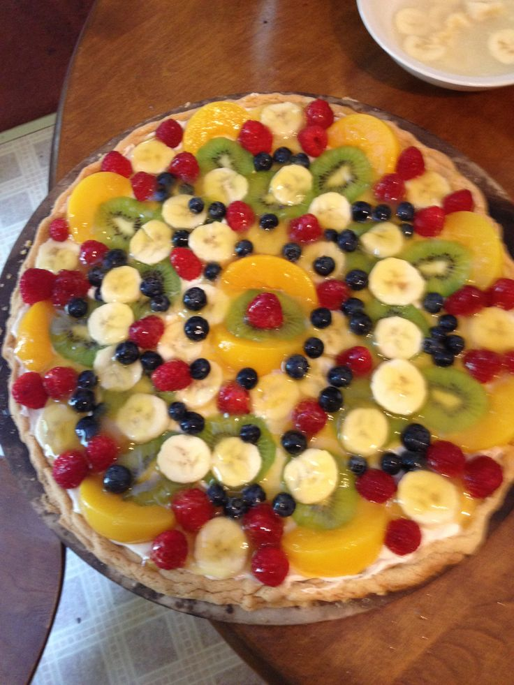 Fruit pizza!  1 pkg sugar cookie for crust  1/2c sugar 1 8oz cream cheese 1 tsp vanilla  Blend together spread over cooked cookie and cover with desired fruit  Glaze 1/2 c orange juice 1/4 cup water 1/2 cup sugar 2tbsp lemon juice 1 tbsp corn starch 1 pinch of salt  Bring to a boil and let Simmer till thick. Pour over fruit