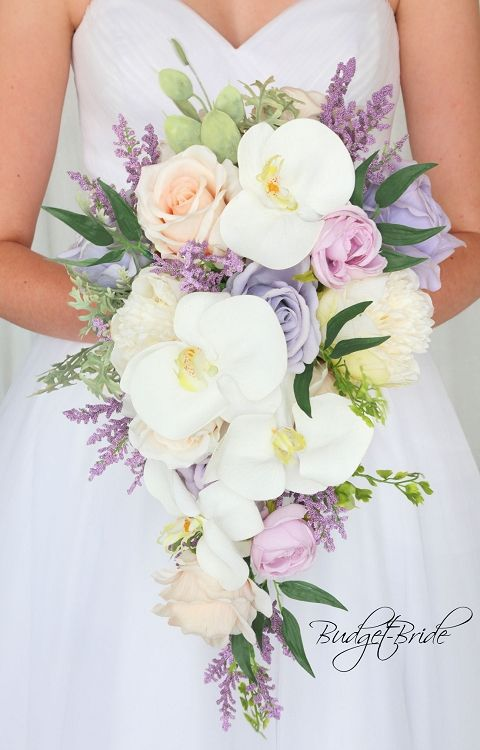 Iris Davids Bridal Wedding Flowers in cascading teardrop bouquet with orchids, peonies and lavender and light purple lilac roses with mixed foliage