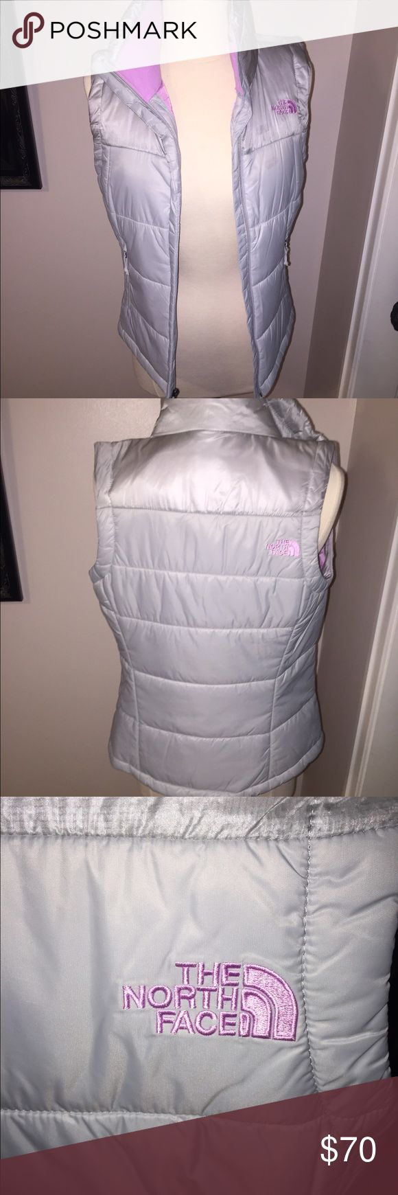 The North Face Vest The North Face silver vest with pink, fleece lining on the interior. Worn once. Size XS. Great condition. WILLING TO NEGOTIATE PRICE! ☺️ The North Face Jackets & Coats Vests