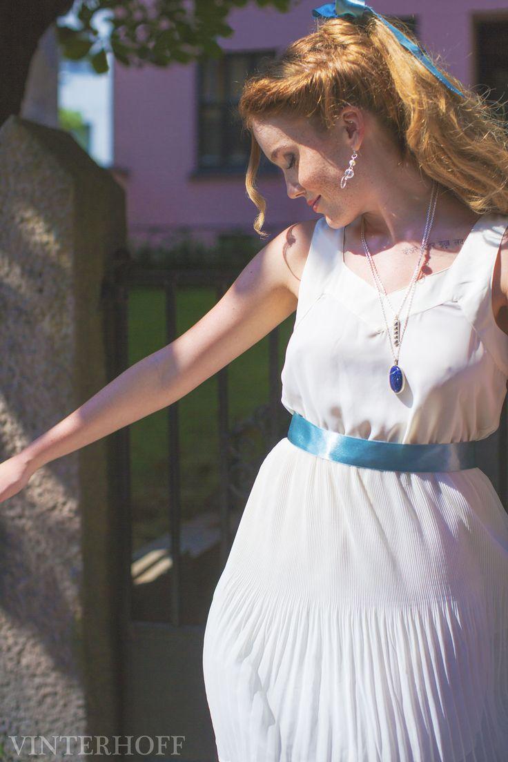 Beauty and the Beast from Disney inspired editorial fashion shoot. Blue silk ribbon in braided hair and a gorgeous white dress. Lapis Lazuli silver pendant.  Model; Karoline - Team Models Stylist; Katrine - Lash Bar Oslo Jewellery; Vinterhoff Photo; Jenny Hoff