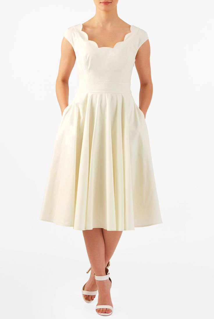 Cotton poplin is shaped into our scallop trimmed dress styled with a wide V-neckline, princess seamed bodice, banded high waist and full circle skirt for a flattering silhouette.