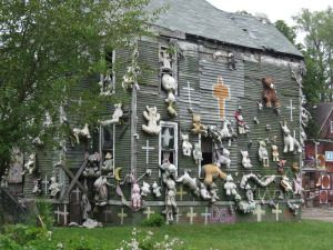 house covered with stuffed animals heidelberg project