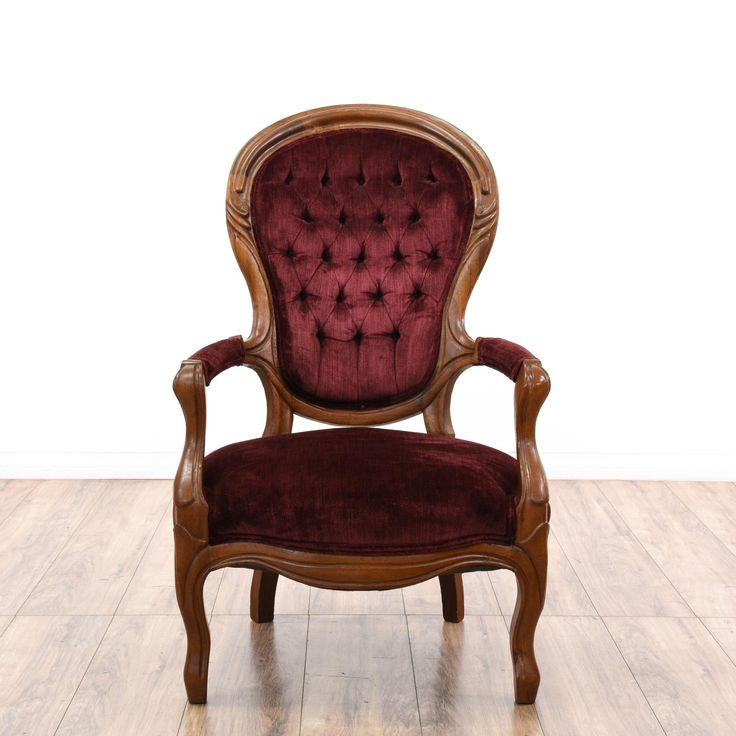 This victorian accent chair is featured in a solid wood with a glossy cherry finish. This stunning armchair has a tufted curved spoon backs with carved trim and deep red velvet upholstery. Eye catching chair perfect for decorating a room! #cottagechic #chairs #accentchair #sandiegovintage #vintagefurniture