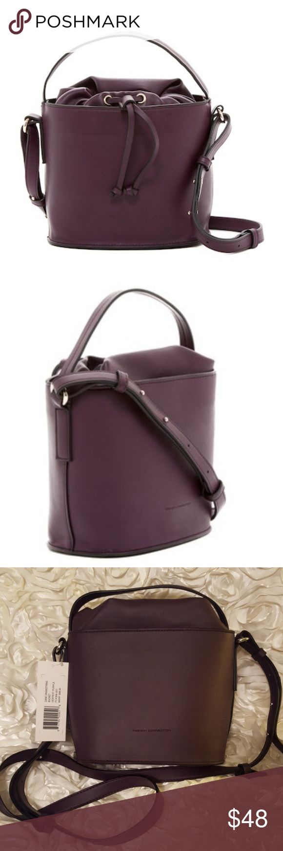 *CCO!*French Connection Dane Drawstring Bucket bag NWT French Connection Dane Drawstring Bucket bag,in the color Deepest Purple. This bag is very unique and cute! It has a single top handle,adjustable shoulder strap,and drawstring top. The interior has one slip pocket and one zip pocket. It measures approximately 8 inches high, 8 inches wide,and 5 inches in diameter. I ship same day or next day! French Connection Bags Crossbody Bags