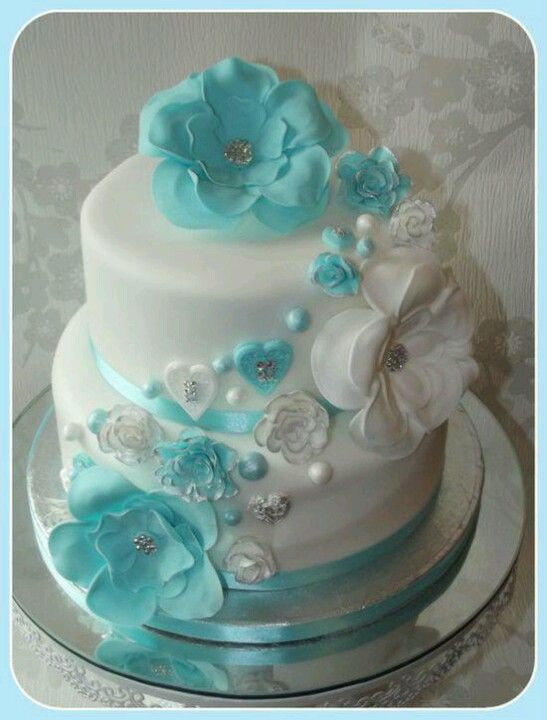 Wedding Cake - blue / aqua / teal / white - floral / beach / tropical - white base - blue & white flowers / decorations - round - 2 tier