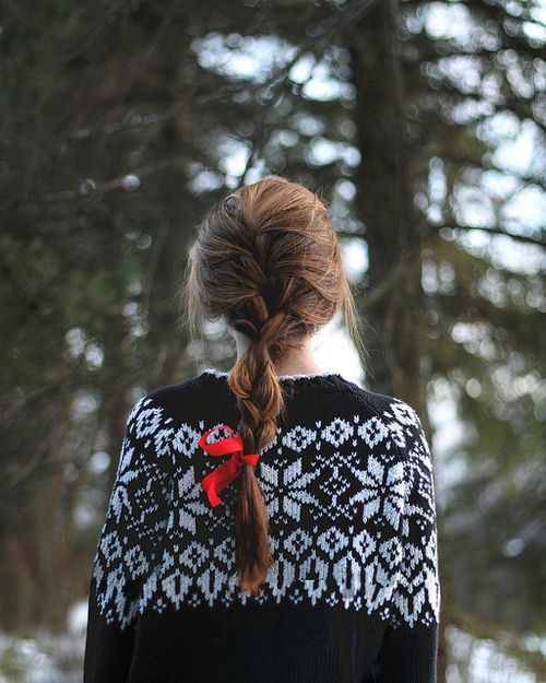 snowflake sweater, loose plait and a red ribbon. winter ready.