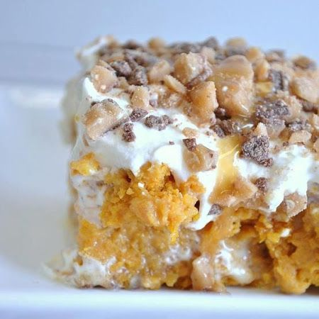 Better than Sex Pumpkin Dessert! Spice cake, pumpkin purée, sweetened condensed milk, whipped topping, caramel, and Heath bits! Holy Yum!