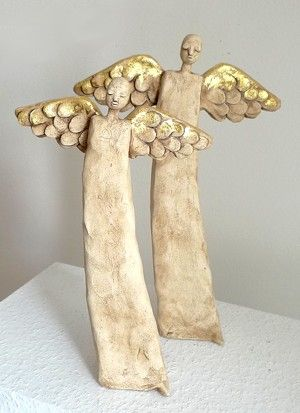 Gold leaf on the wings or metallic power...made here in ceramics but could be made with polymer clay.