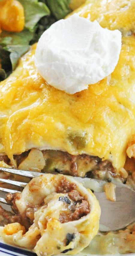 Green Chile Smothered Burrito Recipe ~ These burritos are filled with a delicious ground beef and potato mixture then smothered with green chile sauce and topped with tangy cheddar cheese.