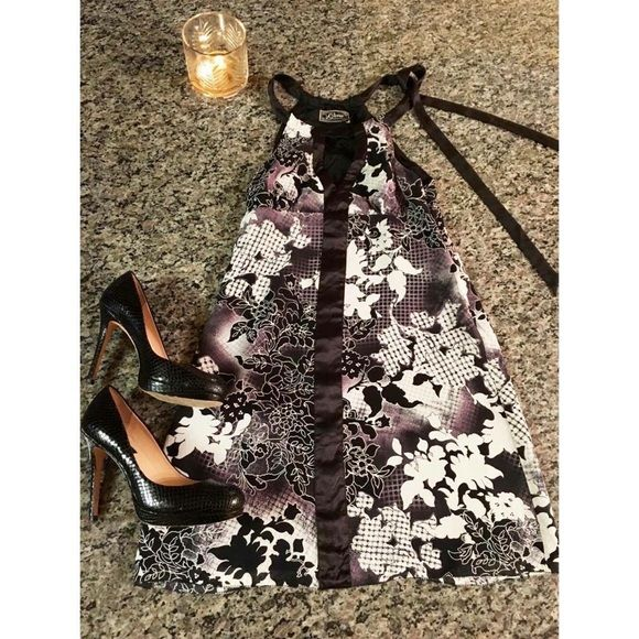 Gorgeous black/white/lavender Guess Dress Perfect for a night out on the town! This dress is a size 3, and  is black and white with hints of lavender. It has a lovely silky satin accent down the front that ties at the top, on the side. Guess Dresses