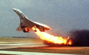 Last picture of Air France Flight 4590, operated with the Concorde, on fire during take-off at Charles de Gaulle International Airport, taken by Toshihiko Sato in an aircraft on a nearby taxiway. 25/07/00