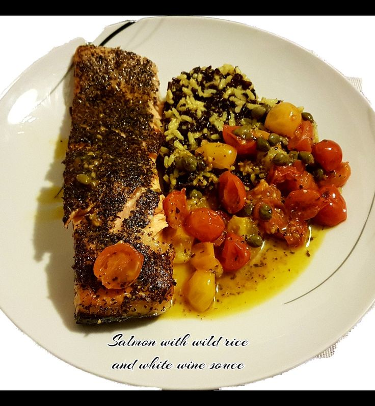 A light dinner!!! Ingredients:salmon fillet,whole rice and wild rice,cerry tomatoes,capers,white wine and olive oil. Spices:salt,pepper,turmeric and aromatic herbs.Tasty!