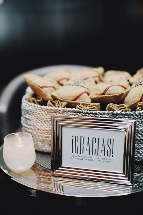 This couple passed out burlap sacks containing Colombian coffee beans as a nod to the groom's heritage | Brides.com
