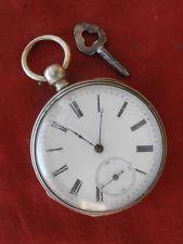 Antiguo reloj suizo bolsillo mecánico cuerda manual año 1850 1890 con su llave