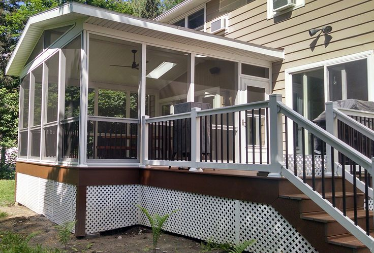 Vinyl railing with aluminum spindles is a stylish and lasting choice for any deck or patio.