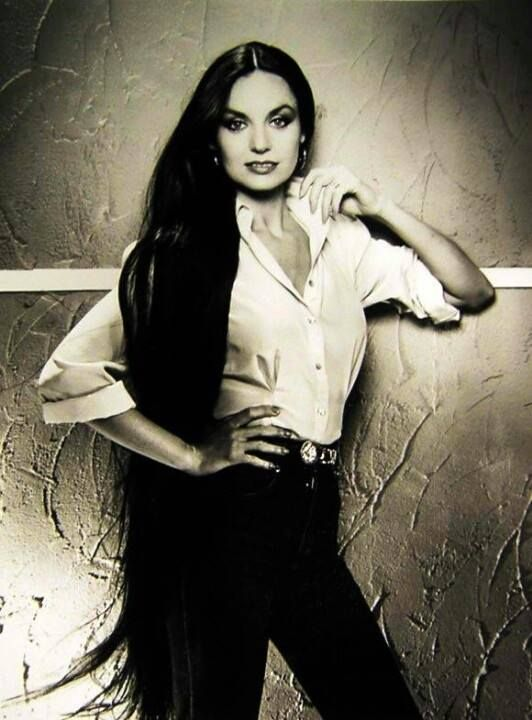 Crystal Gayle....hair that long and beautiful puts you in tha she BAD category