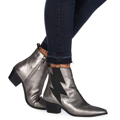 These ankle boots from the 'Nine' by Savannah Miller collection will make a chic update to a footwear collection. Crafted from a soft leather, they come in a metallic finish with an elasticated lightning bolt for added comfort. Style with black denim and a simple white t-shirt for an off-duty appeal.