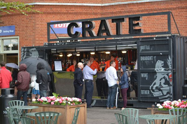 Pop-up shipping container bar. Learn how a pop-up container bar can help your business succeed.