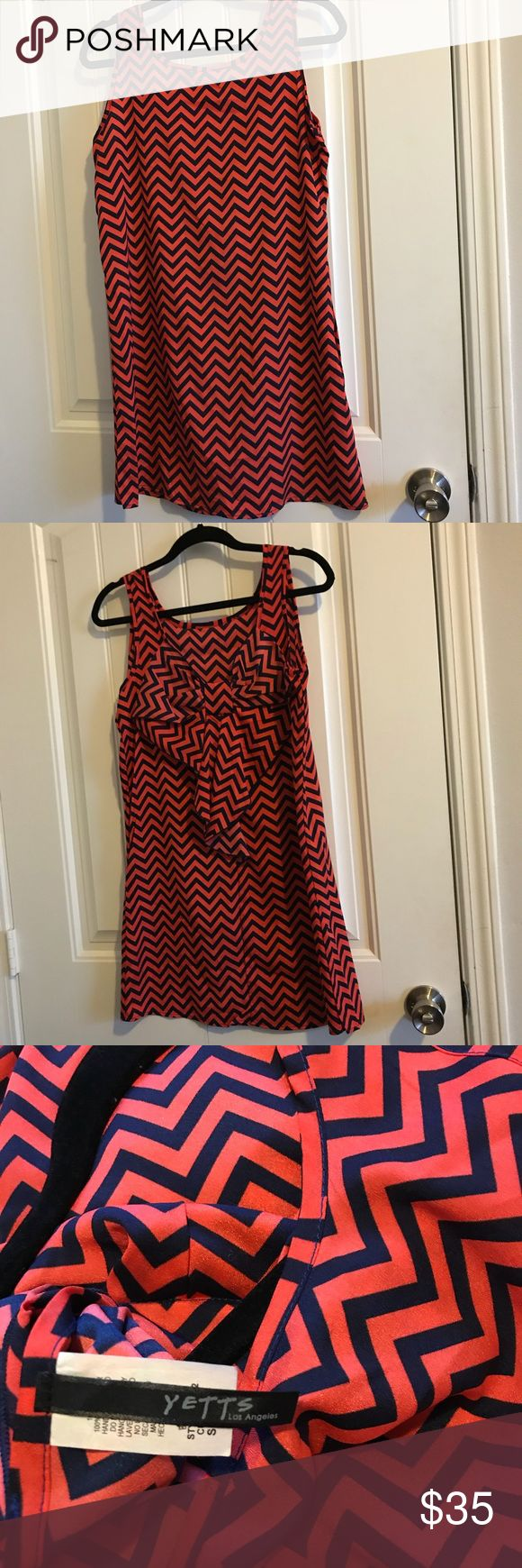Chevron Dress Navy & Orange Navy & Dark Orange Chevron Dress with bow in the back. New without tags. Never worn, in great condition. Dresses