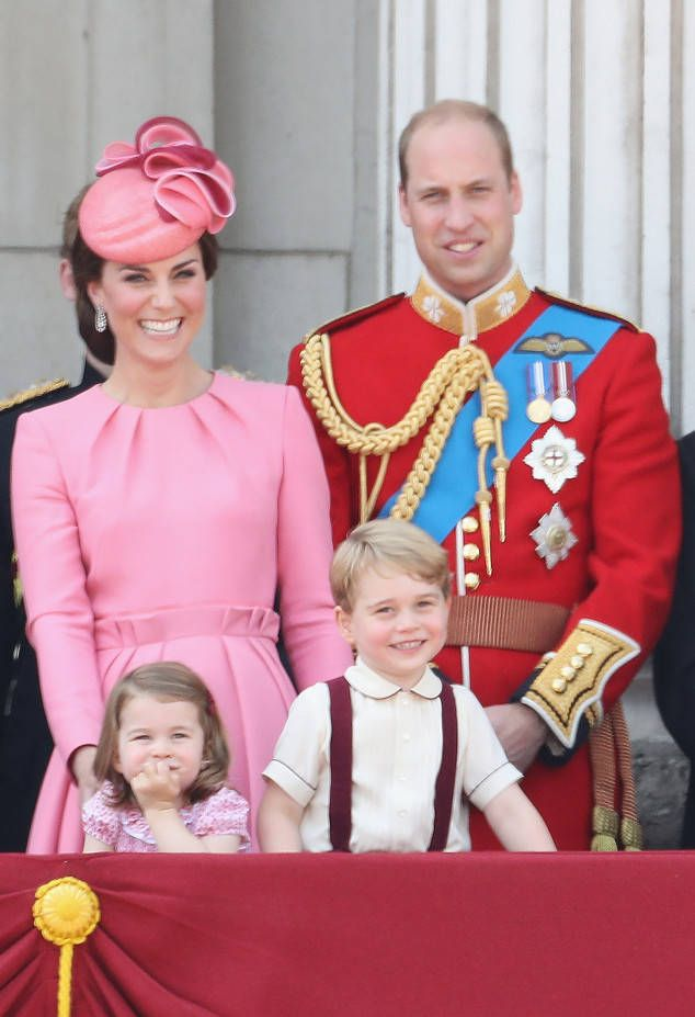 Kate, Prince William and kids Prince George and Princess Charlotte smile at the crowd.