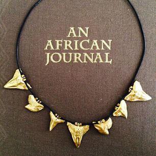 Mikumi Collection, made with gold plated shark teeth pendants