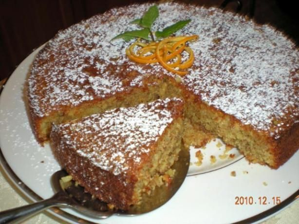 """Moroccan Orange and Almond Cake from Food.com: A moist, flourless cake, using semolina and ground almonds instead. Dust the cake with confectioner's sugar, serve accompanied by strained, plain yoghurt and drizzle the remaining orange syrup around. Decorate with the reserved orange rind and sprigs of mint From the book """"Perfect Baking"""" published by Parragon in 2008."""