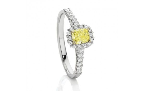 18ct white gold wedding ring, with 0.64ct of diamonds, featuring a 0.40ct Natural Fancy Yellow Diamond.