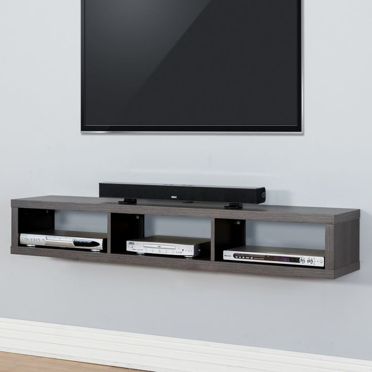 The Martin Furniture Shallow Wall Mounted TV Shelf is compact yet packs  plenty of storage space for a few media.