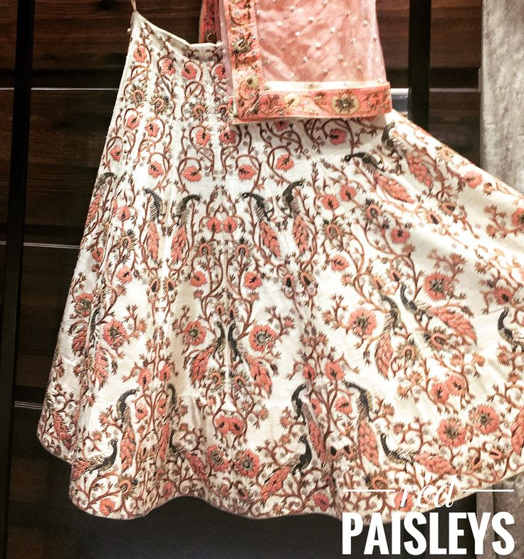 Peach on ivory lehenga choli #birds #character #nature embroidery. For more details  info@redpaisleys.com or 469.248.7733