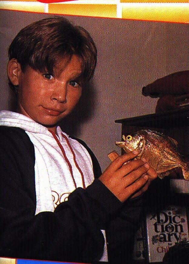 A piranha. WTF? | 23 Photos Of Jonathan Taylor Thomas Holding Things