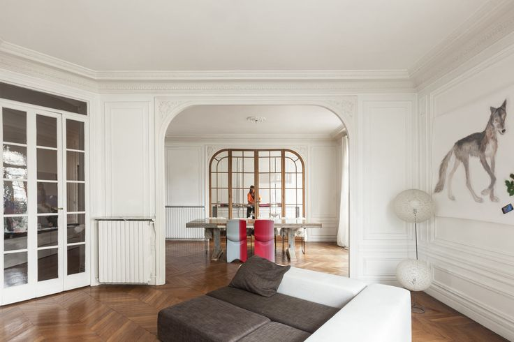 clean white walls, arched doorway with wood frame window