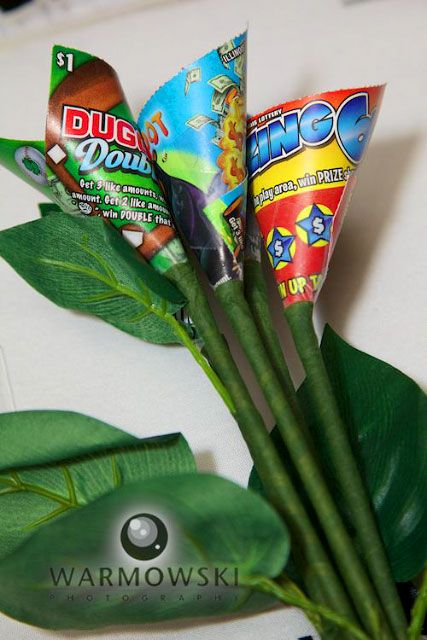 Lottery ticket toss bouquet something fun and different...what girl wouldn't want to catch this??