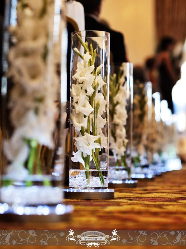 {White Gladiolus flowers lining the aisle} Beautiful! Wedding Photo by: FRP