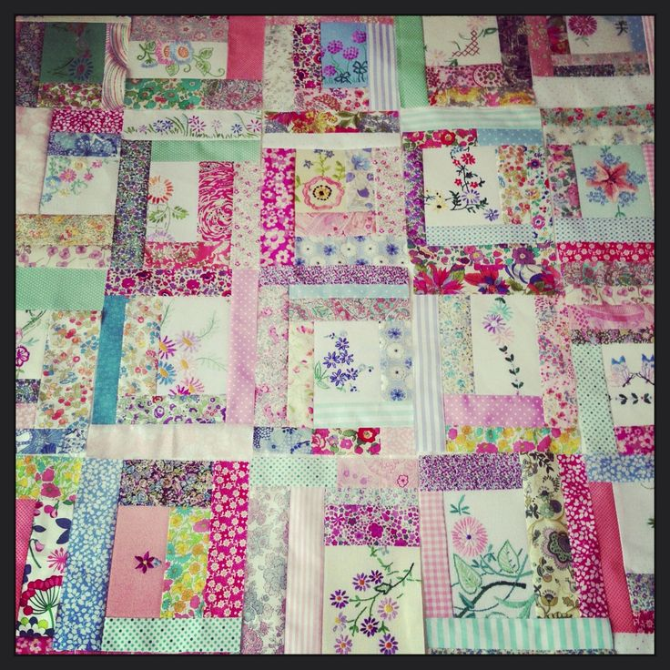 Cutting and piecing together the prettiest part of old handkerchiefs etc. To make blocks for quilts pillows etc