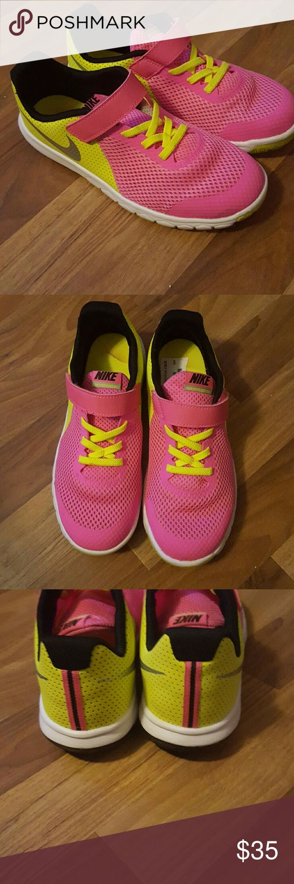Nike  kids running shoes A very cute light as a feather pair of girly Nike shoes ..in bright pink and highlighter yellow with silver Nike  sign on side ..no need to tie ..Velcro  one strap  size 3 youth ..bought for my daughter she loves the style of these shoes..but not the color ! She wore them once bought at Nordstrom rack Nike Shoes Sneakers
