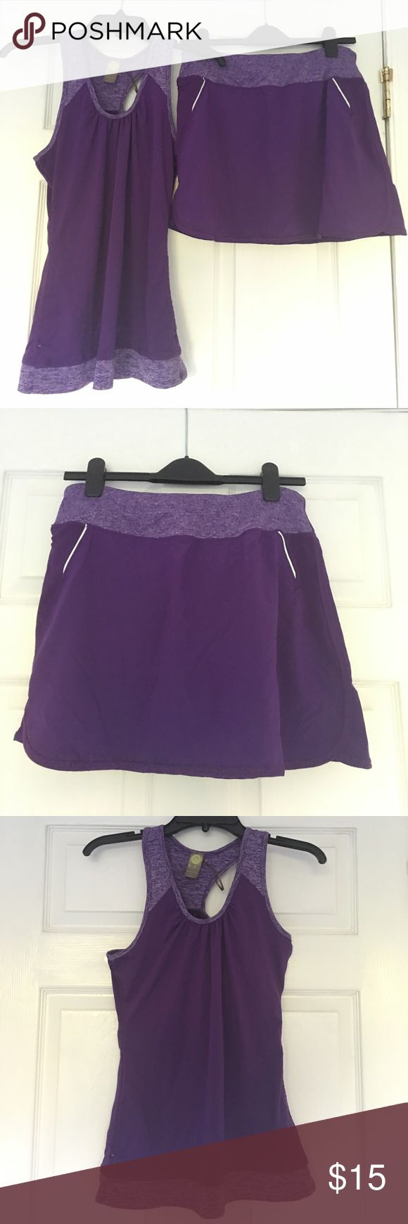 """Kiwi Kate Activeware Set with Tank and Skort Like-new set of athletic tank and skort set by Kiwi Kate. Both made with 4-way stretch and moisture wicking fabric. Skort comes with vented mesh lining underneath in matching purple. Tank measures at 27.5"""" and Skort measures at 14"""" overall.  Super cute set with heather purple trim, perfect to wear for tennis, golf or just a day in the sun!  Available with small or medium Skort, all tanks are small.  Must buy as set. Kiwi Kate Other"""