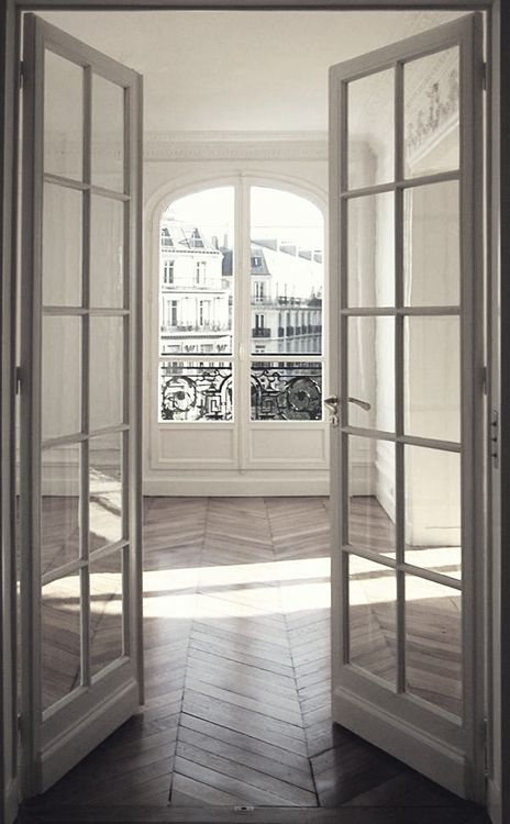 Herringbone wood floors / French doors / whitewashed walls / European flat / apartment / interior design / home