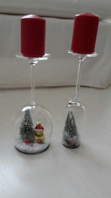Winterlandschaft im wein/sektglas mit Kerzen