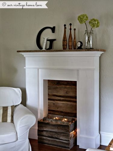 Create a subtle glow with old Christmas lights and a few fake logs. #fireplaces #decor                                                                                                                                                                                 More