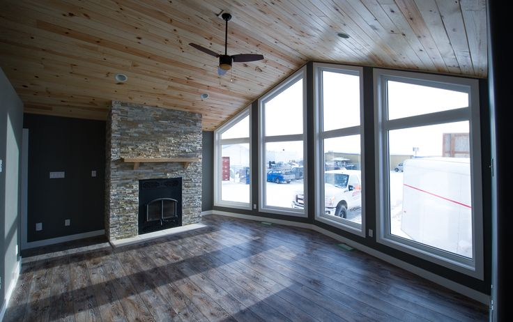 Custom fireplace in the living room of the Madison RTM.   http://bailey-homes.ca/photo-galleries/2014-themadison/