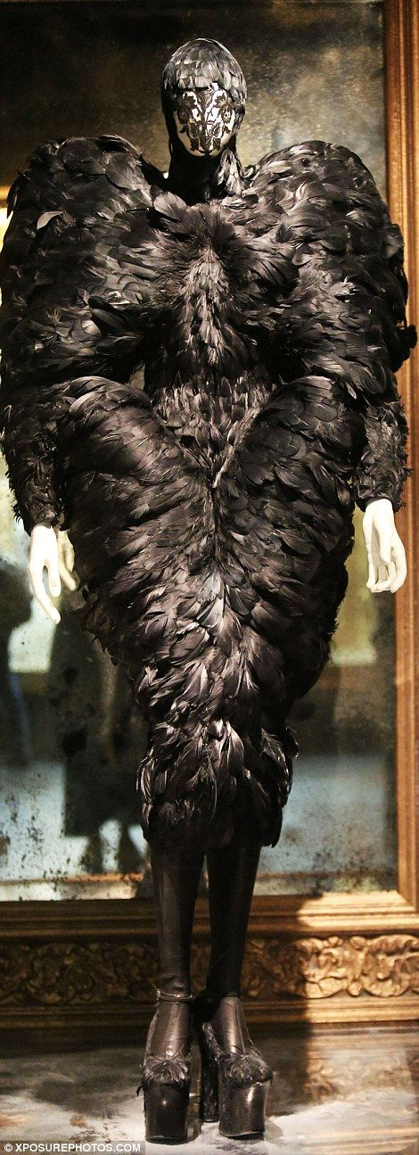 Making a statement: McQueen was celebrated for his bold use of material, including lace and feathers ...