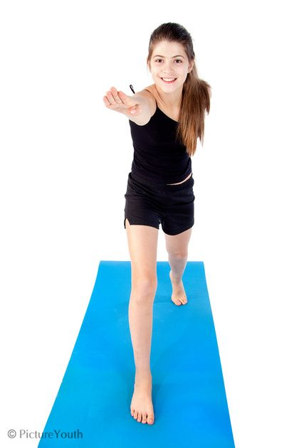 Tween girl practicing a yoga lunge stretch in studio.  #child #fitness #yoga #kids #custom photography  PictureYouth.com