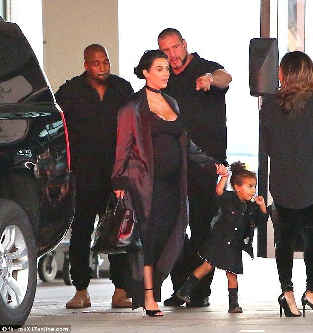 Jetting in: Kanye West was joined by his wife Kim Kardashian and their daughter North, two, as they arrived in San Francisco on Friday ahead of the rapper's performanceat the Democratic National Committee Fundraiser