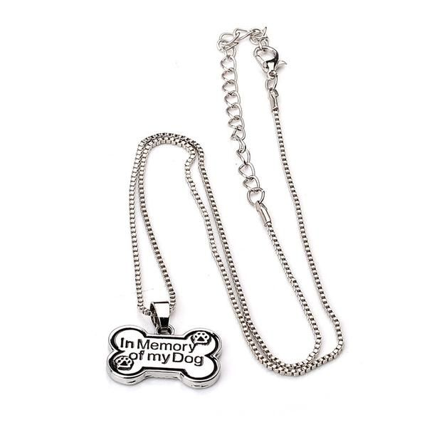 """Memorialize your pup with this hand stamped necklace which features an aluminum dog bone stamped to say """"In Memory of my Dog"""". In Memory of My Dog charm measures 25 mm long."""